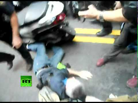 Occupy Wall Street NYPD runs over protester with scooter